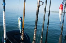 Matzuo Nano Popper, Ugly Stik, and Mann's Bait Redhead Holographic